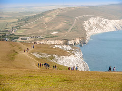 Walkers on the Isle of Wight climb towards the Tennyson Monument on the cliffs above Freshwater Bay (Anguskirk) Tags: uk england monument island eu cliffs hills vectis isleofwight solent southcoast footpath walkers englishchannel freshwater coastalpath tennysondown thenodes alfredlordtennyson tennysontrail