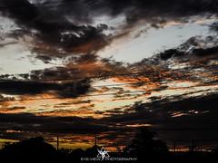Burning Sunset (Eye-View Photography) Tags: trees sunset red orange color beautiful clouds nikon shades explore jamaica caribbean eyeview westindies flickeraward
