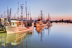Steveston Marina Blue Hour (Patrick Lundgren) Tags: blue light sunset orange fish canada west reflection slr water beautiful vancouver marina photoshop canon georgia photography coast boat twilight fishing sailing ship gulf pacific northwest harbour sigma vessel columbia calm richmond hour british greater dslr trawler steveston cannery 60d