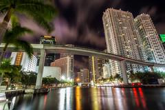 Riverside Miami (Marc Perrella) Tags: city bridge trees water night clouds buildings