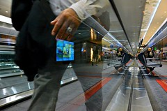 Touch to Start (Pedestrian Photographer) Tags: travel people man reflection start moving airport october colorado pants touch oct screen dia denver traveller sidewalk international reflect mover 5photosaday 2013 dsc1683