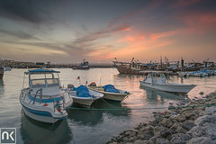 Standby Fishing Boats - Kuwait (AlkhashabNawaf) Tags: pink blue sunset orange beach boats fishing colours fuji purple filter lee nd fujifilm kuwait filters soog nawaf    sharg gnd  xe1    alkhashab