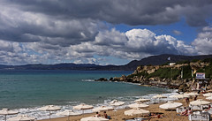 The town beach at Pefkos - Rhodes (Fuji XM1 & 27mm F2.8 Pancake Lens) (markdbaynham) Tags: beach clouds lens landscape greek fuji view hellas x greece grecia scenary pancake trans pefkos rodos rhodes fujinon f28 csc hellenic pefki 27mm digitaldepotcouk