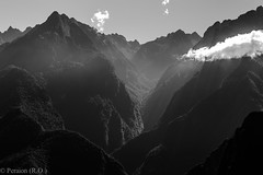 Early rays over the Andes at Machu Picchu, Peru (Peraion) Tags: morning peru america forest sunrise shadows cusco south shades andes rays peaks machupicchu valleys cluffs
