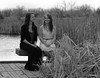 Sisterly Smiles (Miss Marisa Renee) Tags: portrait blackandwhite nature water girl monochrome grass sisters digital canon bench march spring dock pond twins scenery colorado pretty afternoon dress siblings springbreak portraiture figure fraternal lanscape yinandyang digitalphotography greyscale grassy 2014 naturalarea twinsisters riverbendponds figurephotography marisarenee march2014