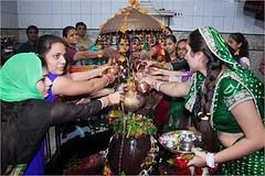 """Surat: Girls performing Abhisek (coronation) to 'Shivling' on occasion of """"Jaya-Parvati"""" at Shiv Temple. (legend_news) Tags: girls temple performing occasion shiv coronation surat abhisek shivling jayaparvati"""