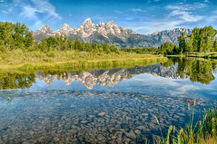 Reflections at Schwabacher Landing (Ronnie Wiggin) Tags: travel sky usa mountains nature field creek sunrise landscape outdoors nikon bravo stream day image images jackson beaver clear kelly mountmoran tetons phot digitalphoto grandteton jacksonhole scenics starburst jh tetonrange naturephotography mountainrange grandtetonnationalpark d300 teatons gtnp mormonrow mtmoran jacksonwy snowcoveredmountains cathedralgroup thethreebreasts photoideas nikond300 beautifulnaturephotos amazingnaturephotos lestroisttons beaverspond rwigginphotos ronniewiggin ronniewiggin mooseschwabacherlanding unitedstatesnationalpark40milelongtetonrangetetonrangejacksonholenationalmonumentrockymountains