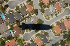 Zeppelin shadow over suburbia (Ian E. Abbott) Tags: shadow ominous suburbia zeppelin 500views airshipventures n704lz modernzeppelin