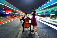 Violinist & Cellist in Traffic (Anatoleya) Tags: city bridge people urban london musicians night long exposure dress traffic performing waterloo le violin cello string lighttrails violinist cellist anatoleya