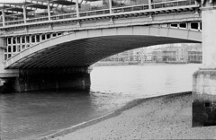Seeing What You Say (G.W Photography) Tags: camera bridge blackandwhite bw london film water composition contrast 35mm river landscape photography photo blackwhite sand poetry experiment flowing grainy riverthames response