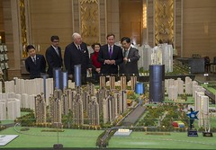 Prime Minister views a model of the World Exchange city in Chengdu (The Prime Minister's Office) Tags: china pm trade primeminister davidcameron