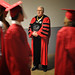 Chancellor Randy Woodson comments on a graduate's shoes as she marches into PNC Arena.