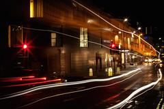 Bus Pass (Julian Pett) Tags: light motion blur bus wet rain night bristol pass trails roads cabotscircus