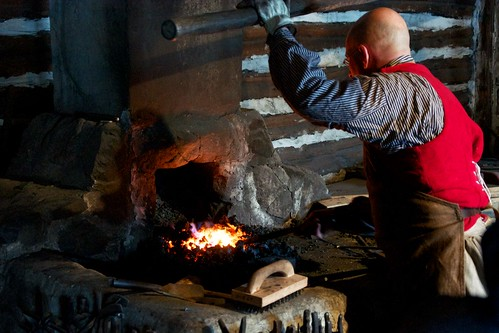 Working the bellows at the forge