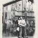 Loving couple leaning on barn wall