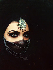 The things I hide within the dark (eset is) Tags: light black silver dark photography eyes veil desert hijab culture makeup jewelry yemen winds saudiarabia bedouin khaleeji arabicmakeup