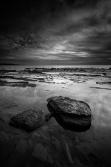 Threatened (Rodney Campbell) Tags: rock ocean gnd09 collaroy water cpl sunrise sky clouds newsouthwales australia au