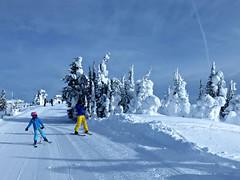 Taking it easy on Juniper Ridge (Ruth and Dave) Tags: catrin child skier liz elizabeth juniperridge topoftheworld sunpeaks skiresort todmountain piste skirun groomed corduroy trees snowghosts mountain view sky clouds skiing weather weatherphotography