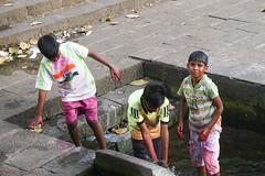 Children at the Holy Festival - Mumbai (DecaFlea) Tags: india bombay mumbai street photography sony color colorful children holy festival tank banganga explore explored