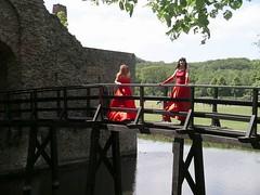 Castle entrance (Paula Satijn) Tags: ladies girls red dress silk skirt gurls gown satin caste ballgown tgirls