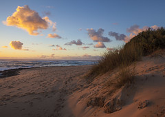 Cloud and Hill at Sunrise (Constantine Savvides) Tags: africa cloud sun beach grass clouds sunrise rising sand african pastel dune fluffy playa afrika rise risen sanddune plage mozambique moz afrique mozambican