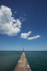 Pierce (pantagrapher) Tags: summer lake chicago tower beach water clouds pier nikon michigan foster lakeshore lakefront d600