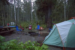 Wet camping (lenswrangler) Tags: camping trees wet water rain forest table mud chairs outdoor tent campfire campground soggy campsite picnictable digikam lakesbasin lenswrangler