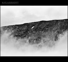 Islands in the sky (KSGarriott) Tags: cloud mountain snow nature norway rock lumix norge blackwhite panasonic ridge fjell jotunheimen gh2 14140 ksgarriott scottgarriott