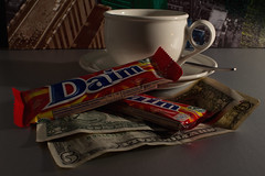 IMG_4220edit (Currant Bun) Tags: blue red brown money green cup coffee yellow silver reflections counter chocolate spoon saucer dollarbill fivedollarbill wallprint daimbar buttersnap
