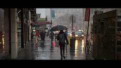 Walking in the Rain (Denn-Ice) Tags: street nyc newyorkcity people cinema ny newyork canon movie manhattan streetphotography cinematic cinemascope streetcandid canon5dmarkiii 5dmk3 cinematicphotos