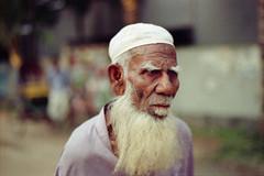 An Elderly Muslim : Critically Endangered  ? (Sheikh Shahriar Ahmed) Tags: portrait film analog beard candid muslim elderly elder fujifilm dhaka bangladesh banasree candidportrait fujicolorc200 dhakadivision sheikhshahriarahmed
