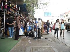 GUDBUD (RubyGoes) Tags: blue india white black tree shoes pavement maharashtra mumbai slippers policeman autorickshaw vendors linkingroad chappals