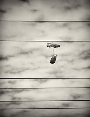 Hang Up Your Boots (hotpotato70) Tags: blackandwhite cloud monochrome sport australia powerlines newsouthwales hanging rugbyboots footballboots bilambil silverefexpro2