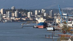 Columbia River Tucked In Behind The Crane Big Johnson (rog45) Tags: canada canon ship bc vessel 7d tugboat tug fraserriver newwestminster freighter rog45 40d f4l2470 f2l135
