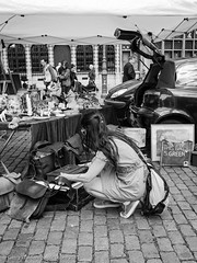 This Bag is Green (gwpics) Tags: people woman vertical lady female person women belgium streetphotography lifestyle belgian antwerp upright society antwerpen socialdocumentary socialcomment antiquesmarket streetpics strasenfotograpfie