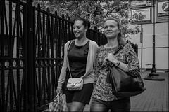 3_DSC9625 (dmitry_ryzhkov) Tags: two fence smile friend girlfriend sony alpha black blackandwhite bw monochrome white bnw blacknwhite woman women lady motion movement walk walker walkers pedestrian pedestrians sidewalk wo art city europe russia moscow documentary journalism street streets urban candid life streetlife citylife outdoor outdoors streetscene close scene streetshot image streetphotography candidphotography streetphoto candidphotos streetphotos moment light shadow people citizen resident inhabitant person portrait streetportrait candidportrait unposed public face faces eyes look looks