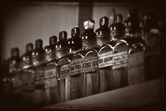 dispensary shelf (friendlydrag0n) Tags: old white black film glass monochrome vintage dark mono bottles antique grain shelf pharmacy drug faux medicine apothecary vignette stopper druggist cherist