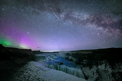 Where Galaxies Meet (TheFella) Tags: longexposure travel winter sky slr water night digital photoshop river stars landscape star photo waterfall iceland nikon rocks europe european purple fineart landmark canyon astro arctic nighttime photograph astrophotography aurora blended processing mystical nordic nightsky dslr awe foss volcanic gullfoss sland constellation northernlights auroraborealis borealis lavendar crevice d800 blending icelandic milkyway goldencircle goldenfalls postprocessing starscape travelphotography hvt earthandspace hvtriver thefella astro:subject=milkyway conormacneill thefellaphotography competition:astrophoto=2013