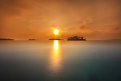 Look into the eyes of the sun (Alexander Ipfelkofer) Tags: ocean longexposure morning travel sea orange sun beach clouds sunrise indonesia island fire paradise jakarta thousandislands idyllic tigerisland pulaumacan nd10
