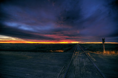 One track mind (Len Langevin) Tags: alberta canada sibbald sunset landscape traintracks railway railroad clouds sky skyscape scenery prairie nikon d300s tokina 1224 night cloudy