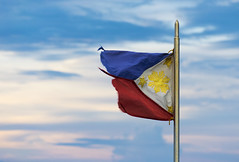 The Philippine Flag (Don Pablo Tan) Tags: blue symbol flag philippines filipino fl ph pinoy philippineflag tattered philippine