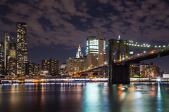 Brooklyn Bridge (Jakub Slovacek) Tags: brooklynbridge eastriver manhattan nyc newyork newyorkcity usa unitedstates architecture bridge building city cityscape clouds downtown landmark lights longexposure night river sky skyline skyscraper travel water