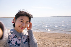 Young woman taking selfie picture at beach (Apricot Cafe) Tags: img24715 2024years asia asianandindianethnicities japan japaneseethnicity sigma20mmf14dghsmart tokyojapan tokyobay beach casualclothing charming cheerful citylife closeup copyspace day enjoyment freedom friendship happiness horizontal humanface indoors leisureactivity lifestyles oneperson onlywomen outdoors photographing photography publicpark relaxation sea selfie sky smiling springtime waistup weekendactivities wind women youngadult edogawaku tōkyōto jp