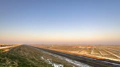 The land behind the Great Protector. (Alex-de-Haas) Tags: 1635mm camperduin d750 dutch hdr hargerenpettemerpolder holland hondsbosschezeewering natuurmonumenten nederland nederlands netherlands nikkor nikkor1635mm nikon nikond750 noordholland thenetherlands westfriesland belichting cloudless daglicht daylight handheld hemel highdynamicrange landscape landscapephotography landschap landschapsfotografie licht light lighting lucht nature natuur onbewolkt polder skies sky sneeuw snow sundown sunset unclouded winter zonsondergang