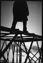 The climb (posts_lv) Tags: uefriday urbexfriday theme ilford delta 100 ilforddelta100 35mm gelatin silver zenit 11 zenit11 helios bw black white blackandwhite dark push 2 reversed process reversedprocessing professional diy diydeveloping push2 tomsmūrnieks pushprocessing monochrome nācuzmanāmtrepēmspēlēties nāc uz manām trepēm spēlēties postapolvpiektdiena postapolv analog film photo transmission tower high voltage electric electricity frame horizontal human man person silhouette climb sky background cloudy clouds steel construction structure lv latvia industrial abandoned menuets outdoor geometric mesh telegraphtuesday