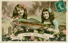 Small Girls with a Large Fish (Poisson d'Avril) (Alan Mays) Tags: ephemera postcards realphotopostcards rppc photos photographs foundphotos portraits greetingcards greetings cards holidays aprilfoolsday aprilfools april april1 april1st 1eravril avril poissondavril aprilfish french france fools fish fishes poisson animals children girls clothing clothes hairbows bows hair flowers roses humor humorous funny comic amusing strange unusual stamps postagestamps tinted handtinted handcolored handpainted pink blue green red banners scrolls ribbons antique old vintage typefaces type typography fonts