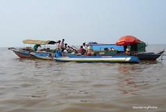 Vietnamese Boat People -Tonle Sap Lake - Cambodia (WanderingPhotosPJB) Tags: umbrella cambodia lake tonlesap boats boat people vietnamese