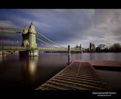 Hammersmith Storm (esslingerphoto.com) Tags: city longexposure greatbritain bridge trees england sky reflection green london wet water thames clouds canon river dark photography evening pier photo still dock europe long exposure shot suspension britain capital hammersmith architectural single gb 5d glassy mkii esslinger esslingerphotocom esslingerphoto