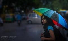 Drenched Memories (Amruth Pillai) Tags: street portrait india color monochrome rain market bangalore national monsoon photowalk seller