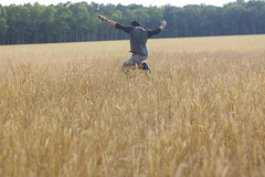 field jumping (peculiarnothings) Tags: portrait field grass jump run